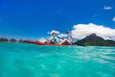 Family paddling at tropical ocean — Stock Photo