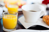Coffee and orange juice — Stock Photo