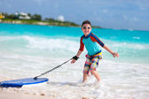 Boy surfing — Stockfoto