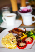 Breakfast with an omelet — Stock Photo