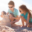 Two kids building sand castle — Stock Photo #46565167