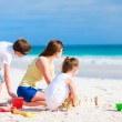 Mother and kids playing at beach — Stock Photo #46565397