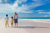 Father with kids at beach — Stock Photo