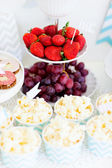 Snack and dessert table — Stock Photo