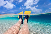 Split photo of  woman legs with fins — Stock Photo