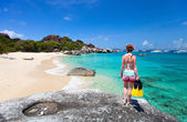 Woman with snorkeling equipment at tropical beach — 图库照片