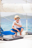 Teenage boy at luxury yacht — Stock Photo