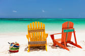 Colorful lounge chairs at Caribbean beach — Zdjęcie stockowe