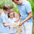 Father and kids with map hiking — Stock Photo #49869367
