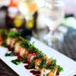 Japanese cuisine sushi rolls — Stock Photo #49869401
