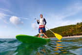 Father and daughter paddling — Stock Photo