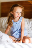 Sweet little girl in light blue pajama — Stock Photo