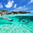 Family snorkeling in tropical water — Stock Photo #50235845