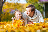 Father and daughter outdoors at autumn day — Stock Photo