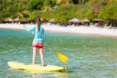 Young sporty girl on vacation — Stock Photo