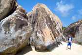 Little boy among huge granite boulders — ストック写真