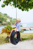 Little girl on tire swing — Stock Photo
