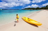 Little girl with kayak — Stock Photo