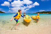 Family kayaking at tropical ocean  — Stock Photo
