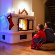 Family at home on Christmas eve — Stock Photo #50623689