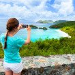 Постер, плакат: Tourist girl at Trunk bay on St John island