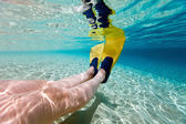 Underwater photo of  woman legs with fins — Stock Photo