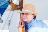 Little girl at luxury yacht with pet dog — Stock Photo