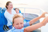 Family enjoying ride on ferry — Stock Photo