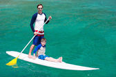 Father and son paddling — Stock Photo