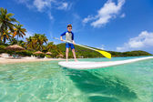 Little boy on stand up paddle board — Stock Photo