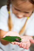 Little girl and snail — Stock Photo