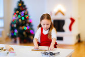 Girl baking Christmas cookies — Stock Photo