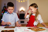Kids baking Christmas cookies — Stock Photo