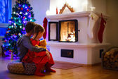 Kids at home on Christmas eve — Stock Photo