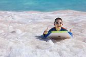 Boy swimming on boogie board — Stock Photo