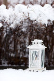 White lantern on snow ground — Stock Photo