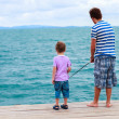 Father and son fishing together — Stock Photo #51413651