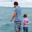 Father and son fishing together — Stock Photo #51413657