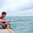 Father and son fishing together — Stock Photo #51413663