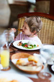 Little boy eating lunch — Stock Photo