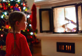 Little girl at home on Christmas eve — Stock Photo