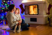 Family at home on Christmas eve — Stock Photo