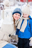 Mother and daughter with Christmas lantern — Stock Photo