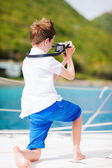 Teenage boy with camera — Stock Photo