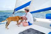 Young woman sailing on a luxury yacht — Stock Photo