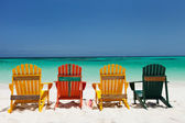 Colorful chairs on Caribbean beach — Stock Photo