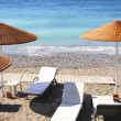 Beach chairs and umbrellas - Stock Photo