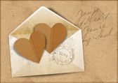 Vintage background with envelope and hearts — Stock Photo