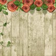 Old wooden background with paper roses and with space for text — Stock Photo #29252459