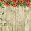 Stock Photo: Old wooden background with paper roses and with space for text